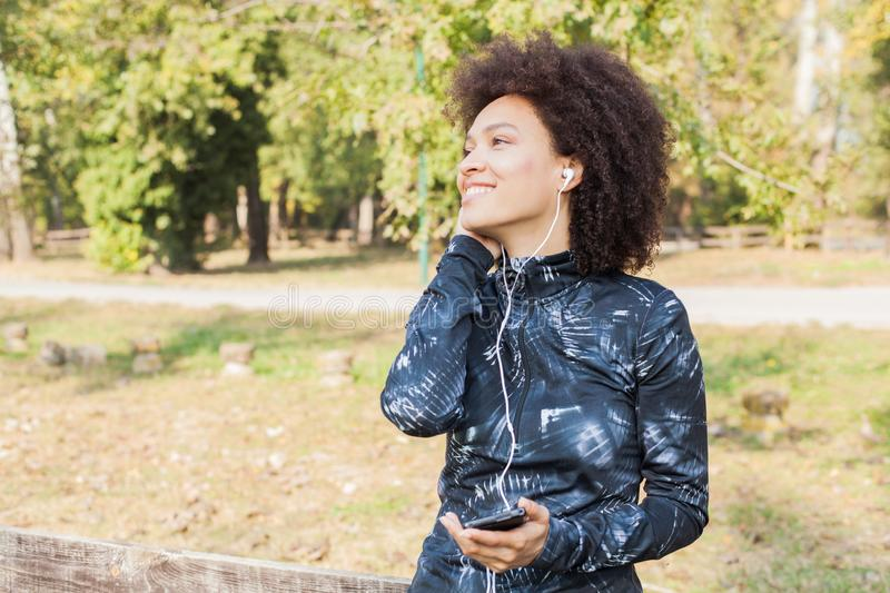 Beauty And Happy Afro Woman Listening Music After Running royalty free stock image