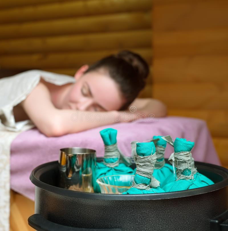 Beauty and health. Thai massage with salt bags stock photography