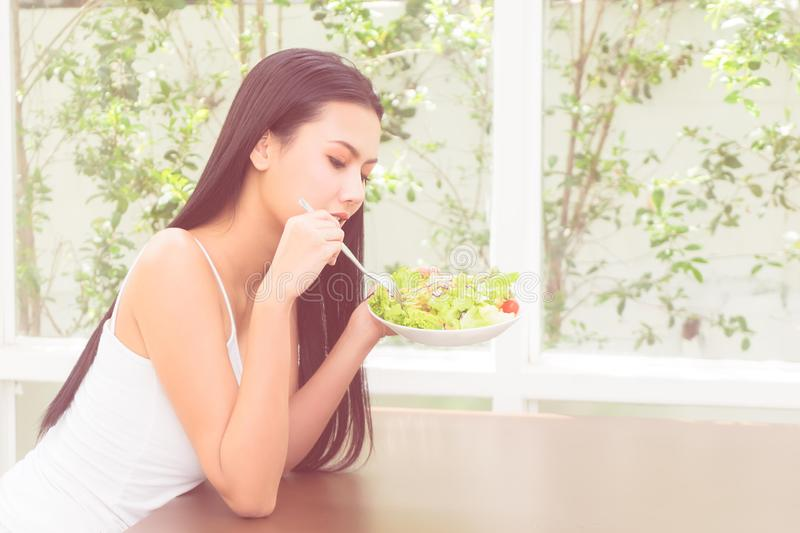 Beauty and healthy woman having vegetable salad at home for Beauty and healthy eating for woman concept royalty free stock photo