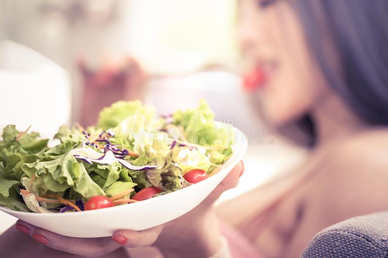Beauty healthy woman is having vegetable salad at home for Beauty and healthy eating for woman concept stock photography
