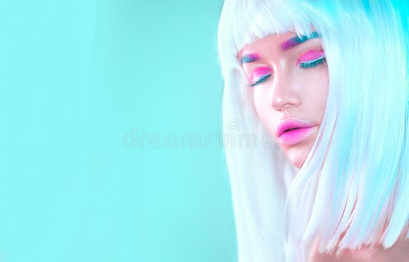 Beauty high fashion model girl portrait with white short hair, trendy pink eyeliner, gradient lips. Futuristic art make-up in whit stock photos