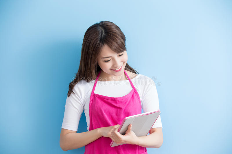 Beauty housewife take tablet. And smile isolated on blue background, asian stock photos
