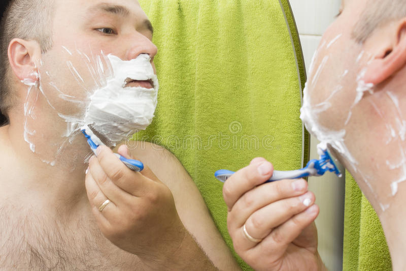 Beauty, hygiene, shaving, grooming and people concept stock photography