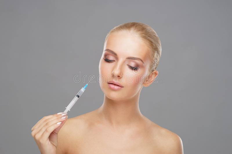 Beauty injection in a face of a young woman. Plastic surgery concept. Beauty injection in a face of a young woman. Plastic surgery, skin lifting and aesthetic royalty free stock photos