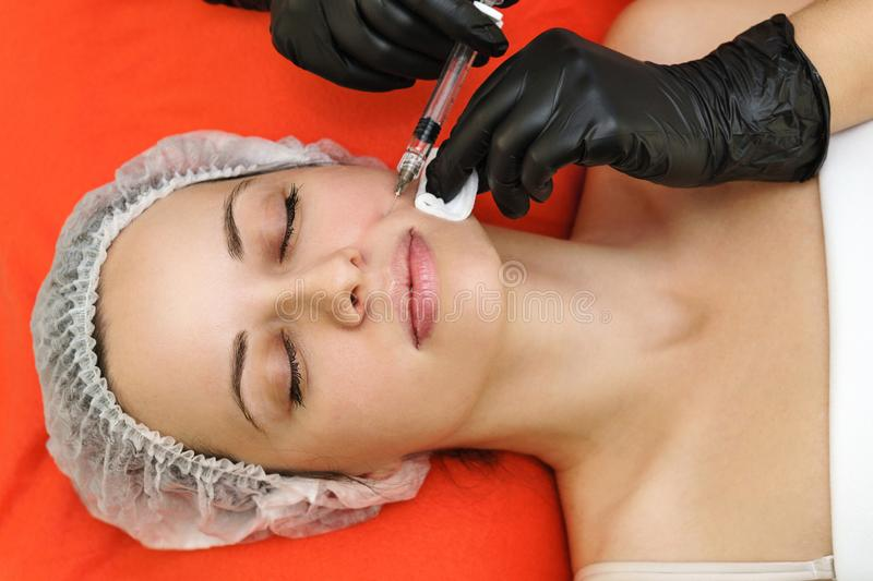 Beauty injections. Medical procedure in spa salon royalty free stock image