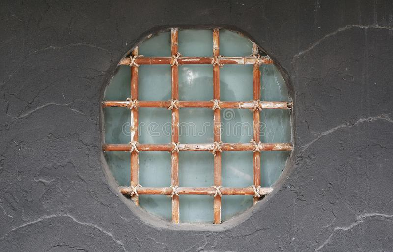 The beauty of Japanese decorative design window on the abstract gray cement wall royalty free stock images