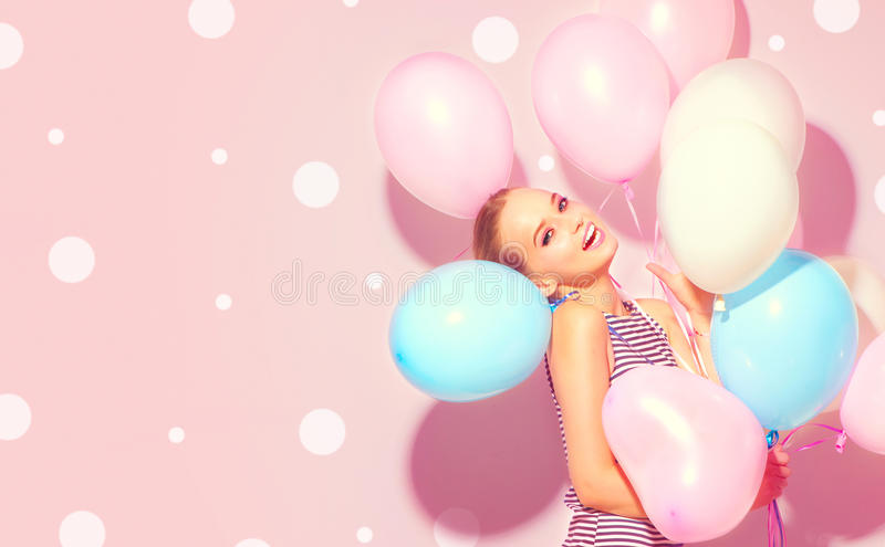 Beauty joyful teenage girl with colorful air balloons stock images