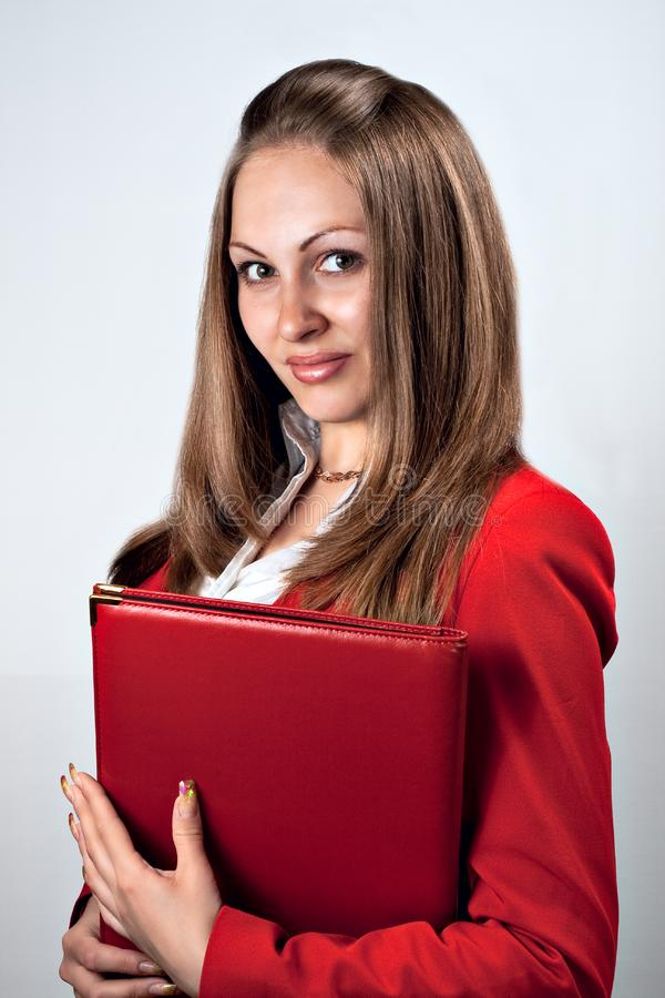 Beauty lady holding red folder stock images