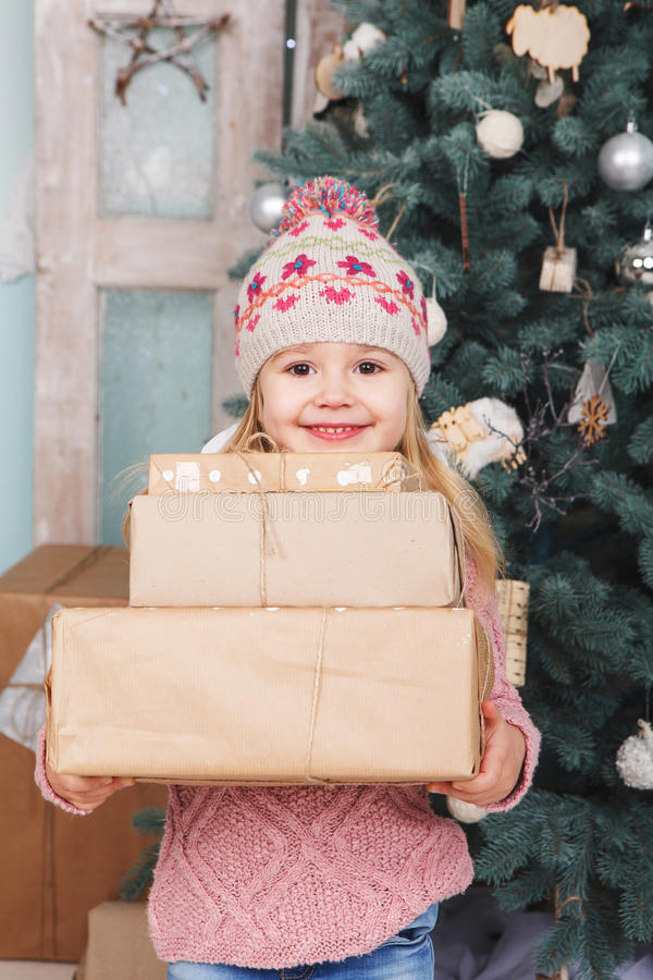 Beauty little girl with new year gifts stock images