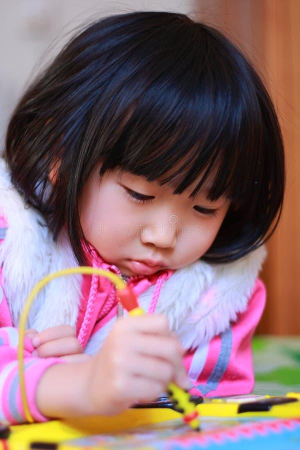 Beauty a little girl writing stock photo