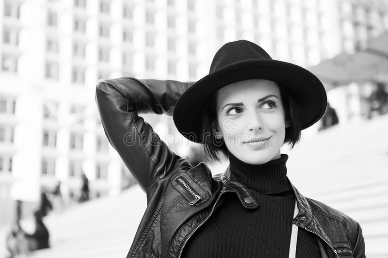 Beauty, look, makeup. Woman in black hat smile on stairs in paris, france, fashion. Fashion, accessory, style. Sensual royalty free stock images