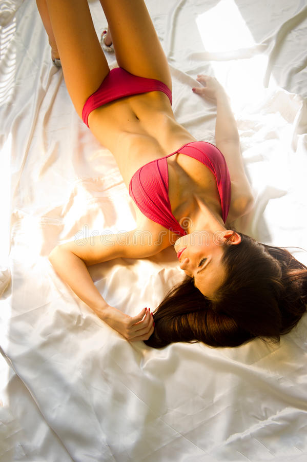 Download Beauty lying on the bed stock photo. Image of body, pretty - 18771506