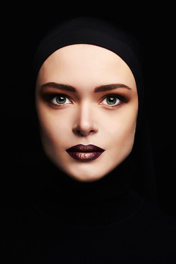 Beauty make-up.beautiful woman face like a mask. female mask isolate on black. Fashion girl with professional make-up stock photo