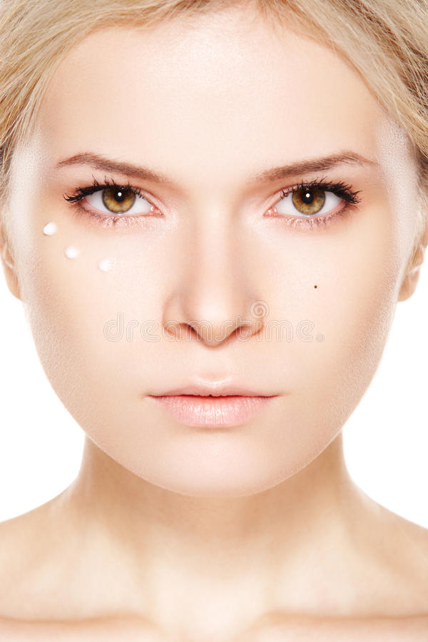 Beauty, make-up & cosmetic. Woman with daily cream stock photography