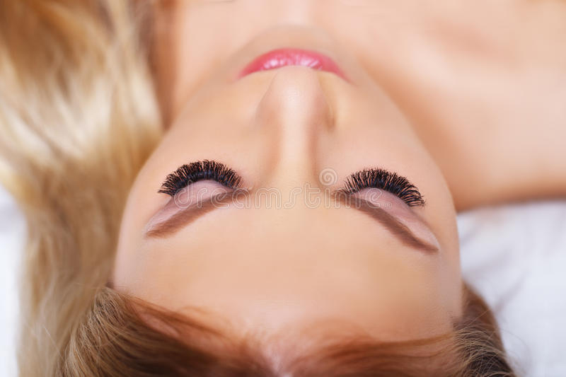 Beauty makeup for blue eyes. Part of beautiful face closeup. Perfect skin, long eyelashes, make up concept. stock image