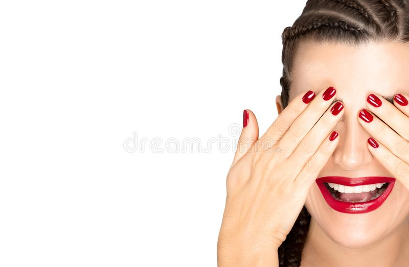 Beauty and makeup concept with a smiling woman with braided hair, ed nail polish and lipstick stock photo