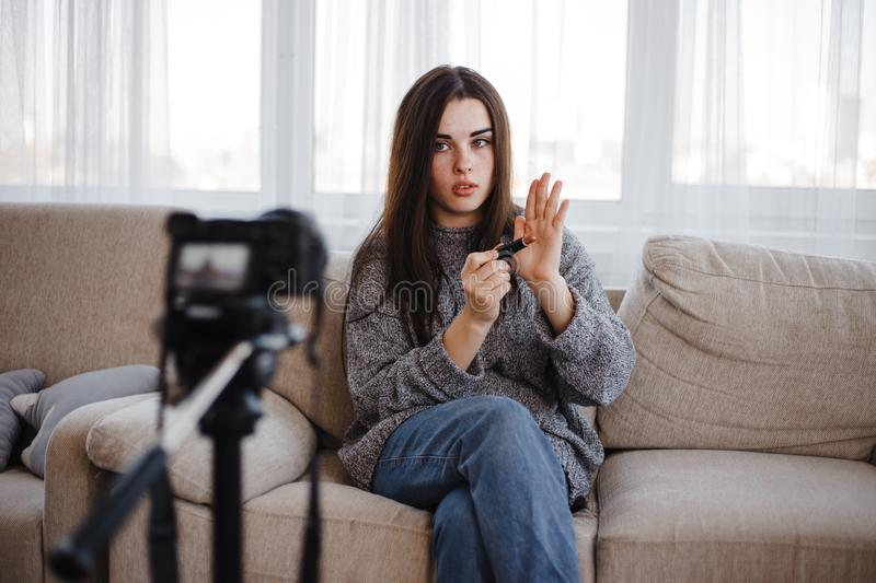 Young vlogger recording a make-up video for vlog stock photography