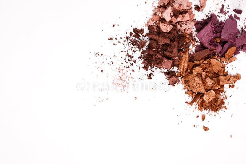 Beauty, makeup cosmetics, eyeshadow splash palette. Makeup cosmetics. Eyeshadow crushed palette, colorful eye shadow powder on white background stock images