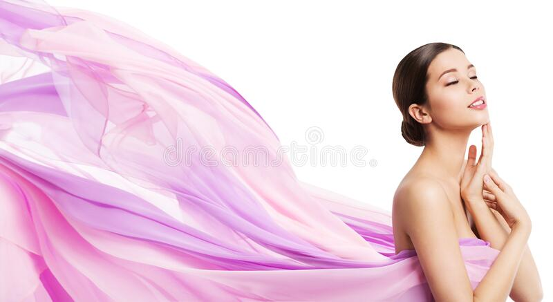 Beauty Makeup Skin Care, Woman Touching Face, Young Girl in Pink Waving Cloth Fluttering Wind on White royalty free stock images