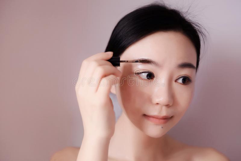 Beauty makeup woman putting mascara eye make up royalty free stock photos