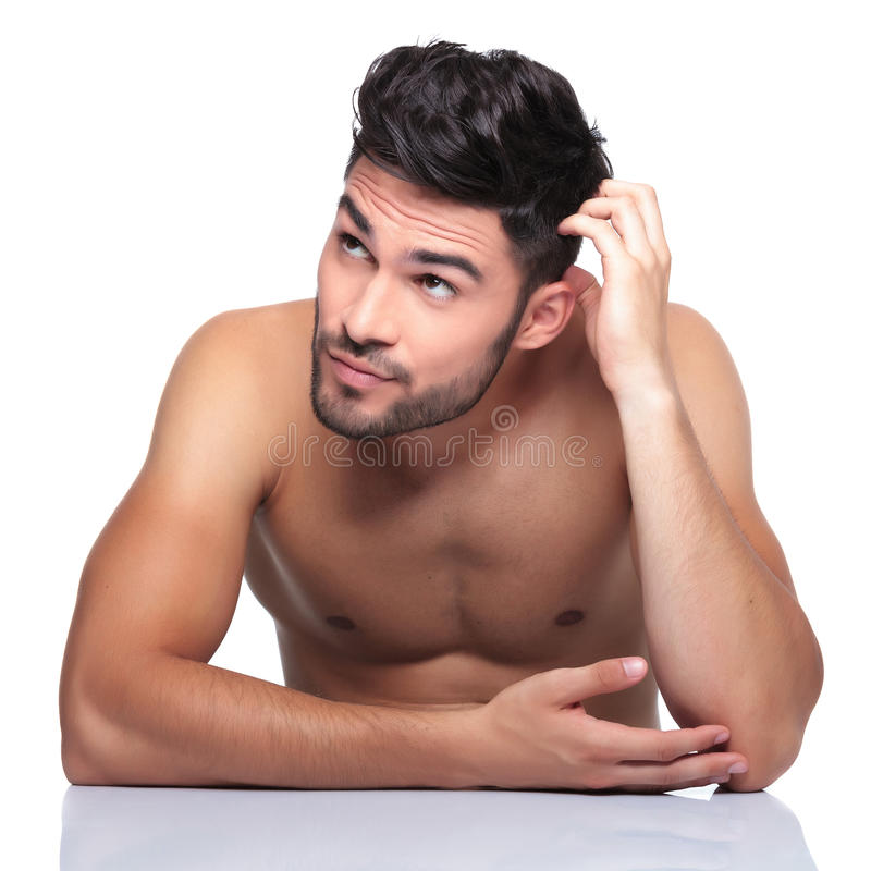 Free Beauty Man Scratching His Head And Looking Up To His Side Royalty Free Stock Photos - 35446358
