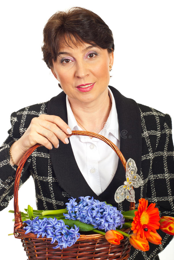 Download Beauty Mature Woman Holding Flowers Stock Photo - Image: 18621264