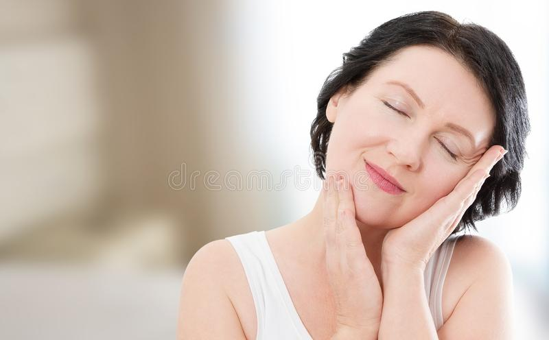 Beauty middle age woman sleep face portrait. Spa and anti aging concept at home background. Plastic surgery and collagen. Wrinkles stock photography
