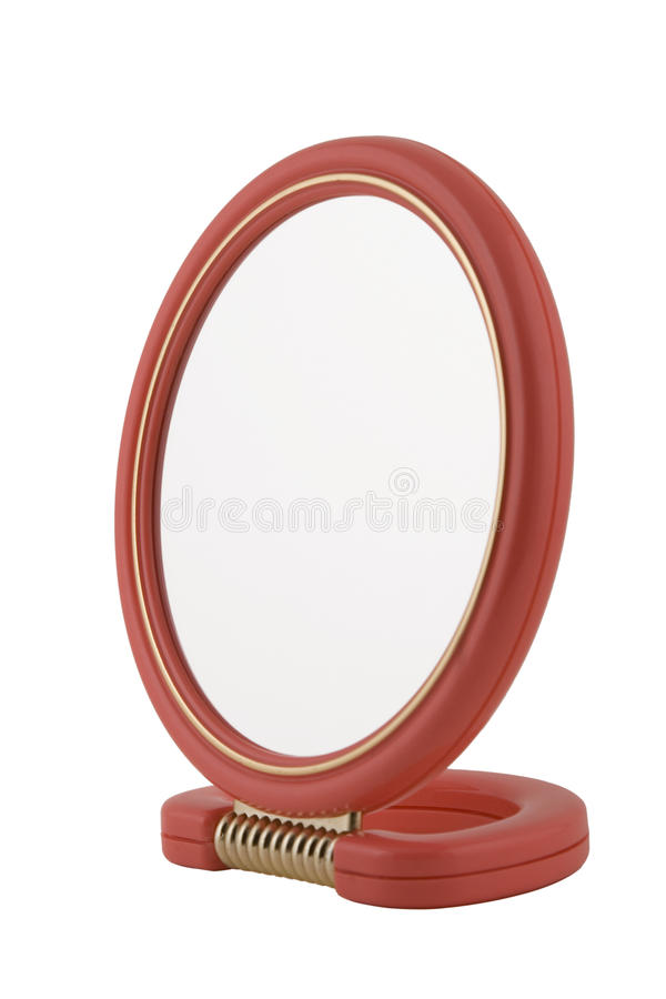 Beauty mirror with red frame and handle. On white background stock photography