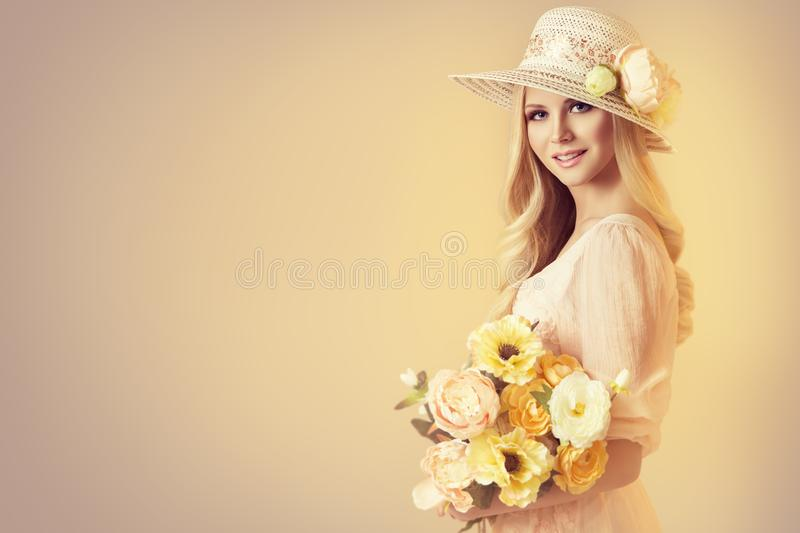 Beauty Model in Fashion Broad Brim Hat, Woman and Peony Flowers stock images