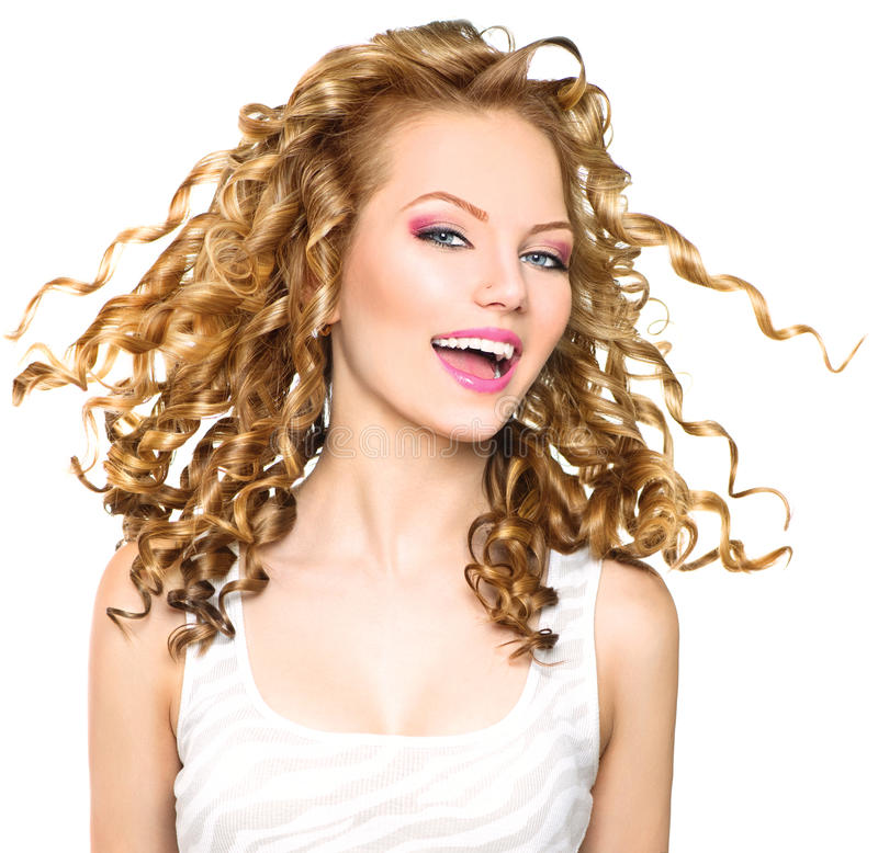 Beauty model girl with blonde curly hair. Beauty model girl with blowing blonde curly hair stock images