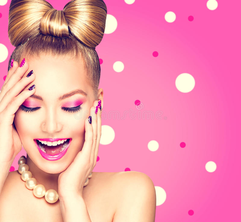 Beauty model girl with bow hairstyle. Over polka dots background stock photo