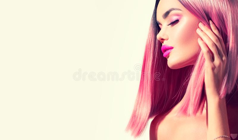 Beauty model girl with perfect healthy hair and beautiful makeup. Ombre pink dyed hair. Beauty model girl with perfect healthy hair and beautiful makeup. Ombre stock photo