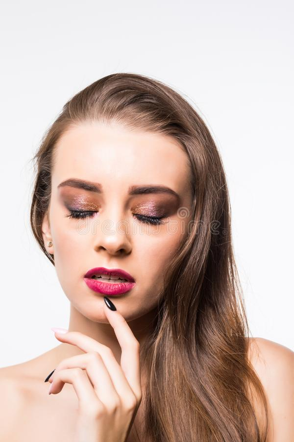 Beauty model girl with perfect make-up looking at camera isolated over white. Portrait of attractive young woman with long hair on stock images