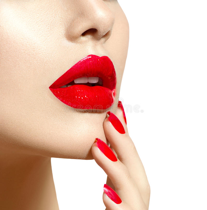 Beauty model girl with red lips and nails closeup. Manicure and makeup royalty free stock photos