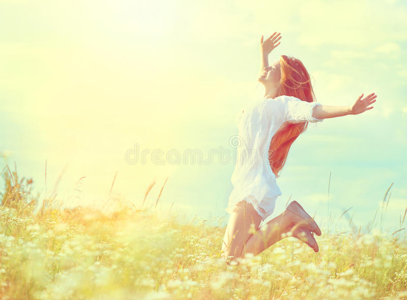 Beauty model girl in white dress jumping royalty free stock images