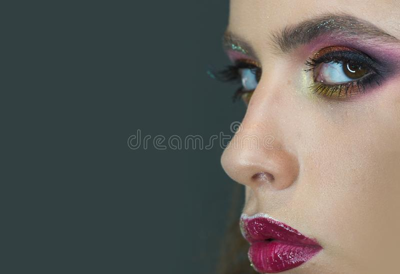 Beauty model with glamour look, makeup. Woman with eye makeup and purple lips, beauty. Woman with young skin face stock images