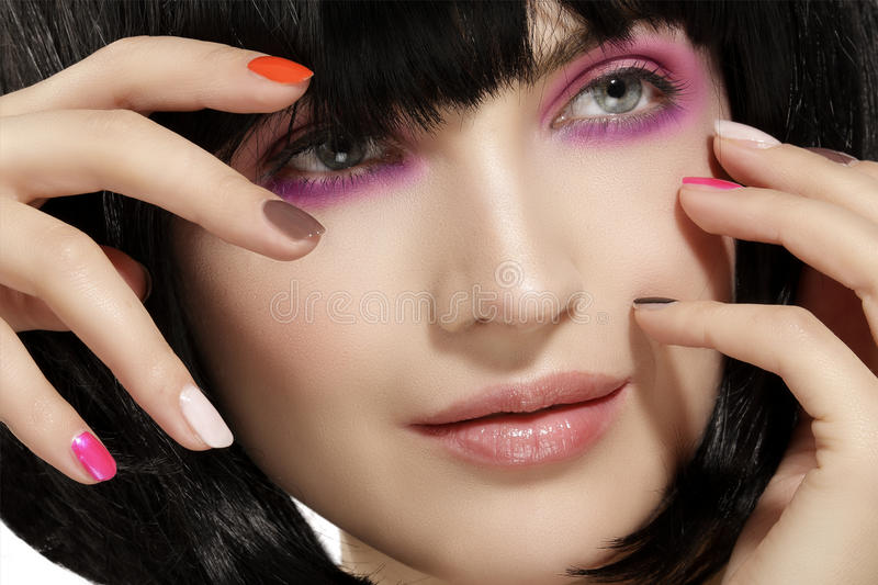 Beauty model hairstyled and pink eye shadows makeup closeup royalty free stock images