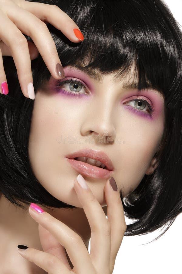 Beauty model hairstyled and pink eye shadows makeup closeup stock photos