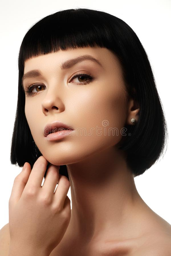 Beauty model with perfect glossy black hair. Close-up portrait. Portrait of a beautiful woman in short brunette bob with neat clean hair. Fashion bob hairstyle stock photo
