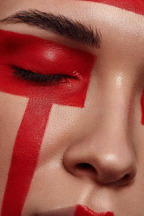Beauty Model with red painted Geometry on Face stock image