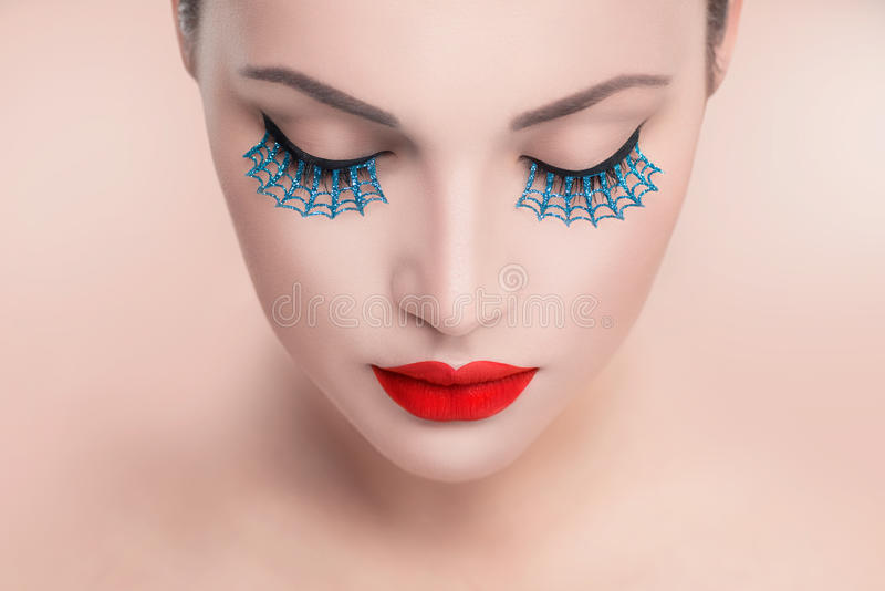 Beauty model woman with red lips and blue false eyelashes royalty free stock image