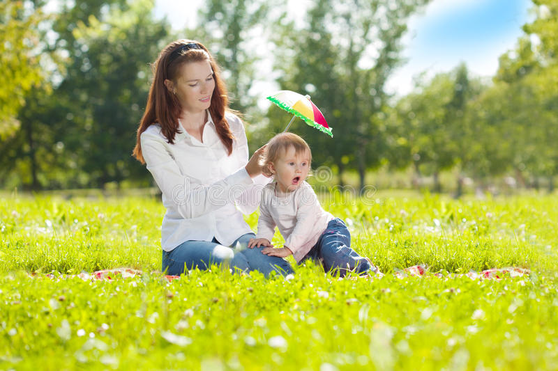 Download Beauty Mom And Baby Outdoors. Happy Family Playing In Nature. Mo Stock Photo - Image of green, baby: 40760424