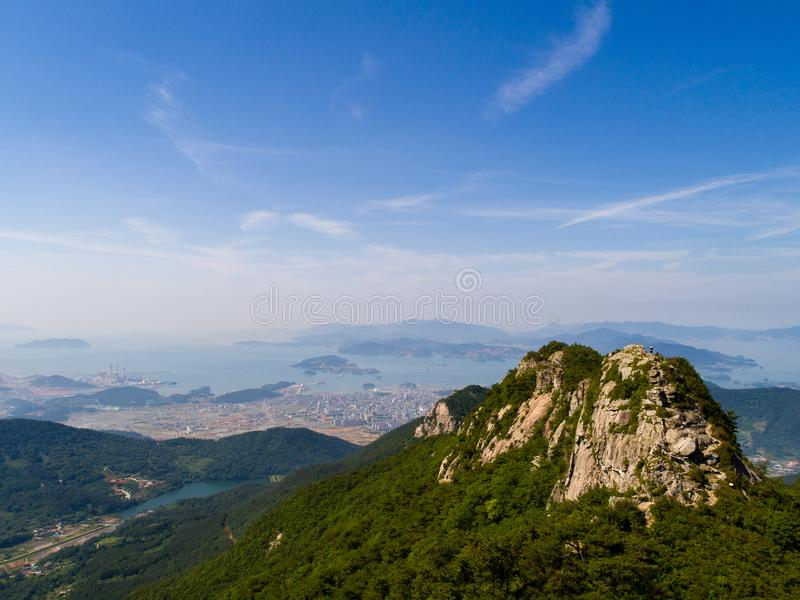 Rocky mountain peak, surrounding small village, city, sea and islands stock photography