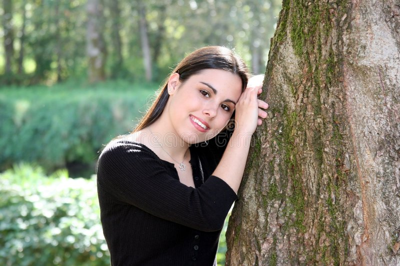 Beauty in Nature. A very pretty teenage girl modeling for a photo shoot stock photography