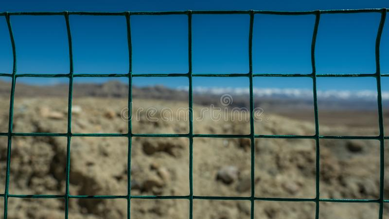 Blue sky fences Grid web. Beauty of nature caught from behind the fences stock image