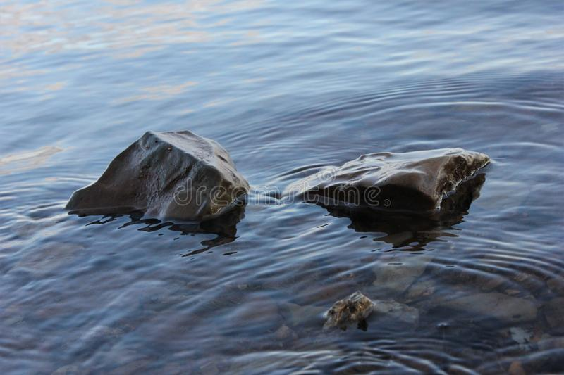 Water Rippling around Two Rock`s royalty free stock photography