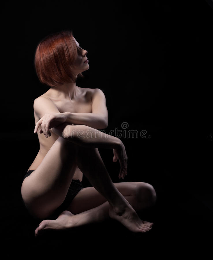 Beauty nude woman sit on black stock photos