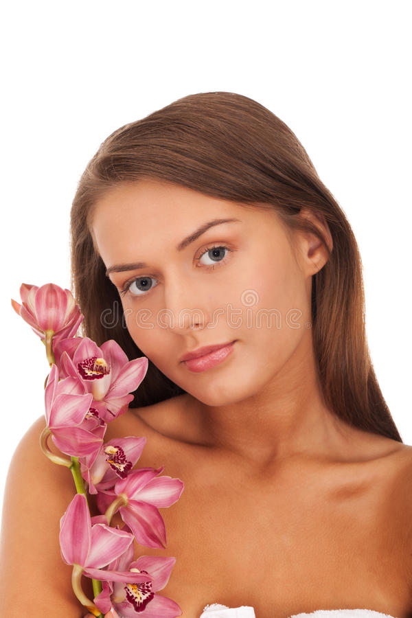 Beauty with orchid. Young lady with orchid isolated on white background stock photos