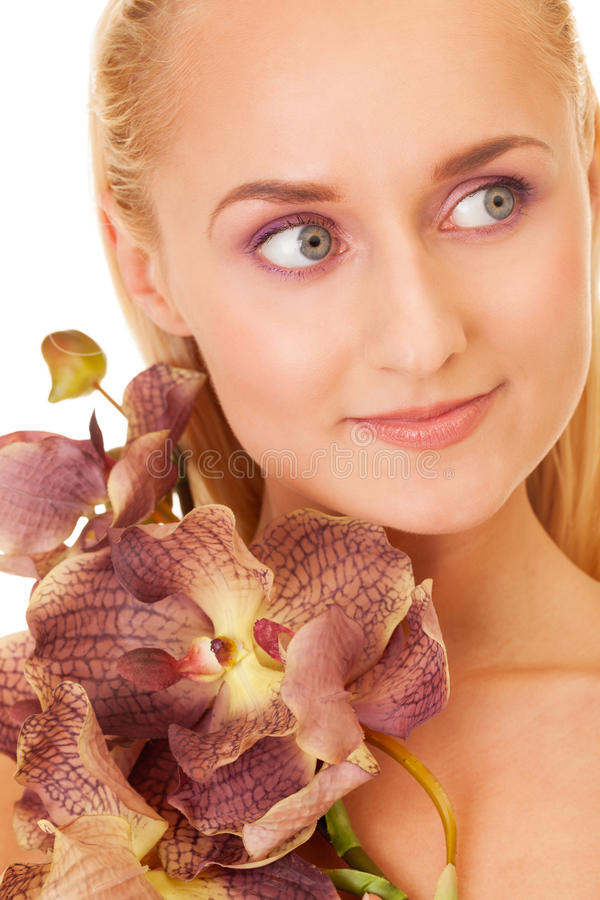 Beauty with orchids. Portrait of a beauty with orchids stock photo