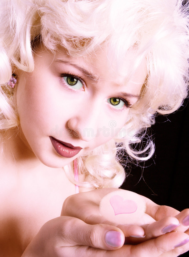 Beauty pink girl with heart in hend stock photo
